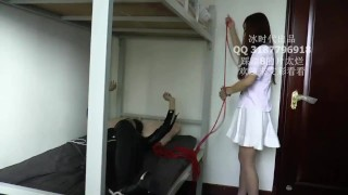 Two Chinese girl tickle each other in nylon