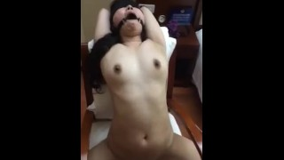 Chinese girl strapped to a chair, BDSM pleasure